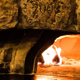 Wood-fired pizza - Pizzeria Pont du Rhône